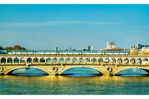 Metro train on the Pont de Bercy, a bridge over the Seine in Paris, France