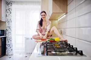 Sexy brunette in the kitchen