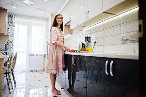 Sexy brunette in the kitchen