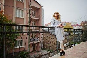 Stylish curly blonde model girl