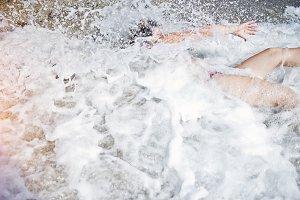Drowning woman at the sea
