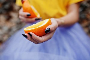 orange at in girl hands