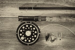 Vintage fly reel and rod with flies
