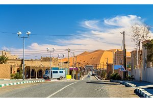 View of a Saharan dune from a street in Merzouga village, Morocco