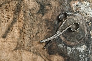 Antique scissors wooden background