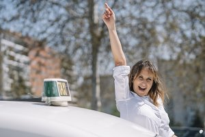 Woman driver of auto taxi vehicle