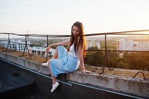 Girl on roof at sunset