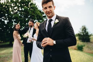 Handsome groom looking happy