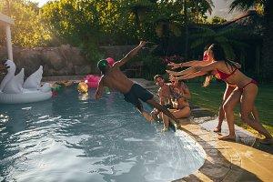 Friends enjoy pool party