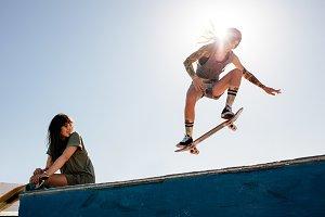 Woman skateboarding at park