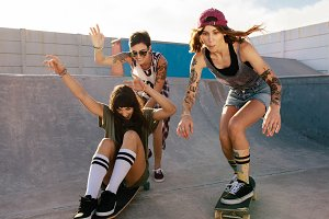Group of women riding skateboards