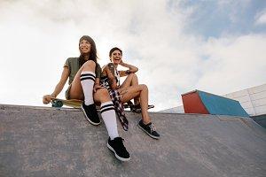 Urban girls in skate park laughing