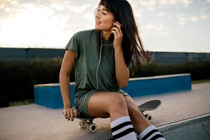 Woman relaxing at skate park
