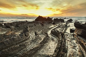 Barrika roky beach at sunset