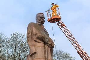 LVIV, UKRAINE - April 16, 2018: Cleaning expert clean the monument to Ivan Franko.