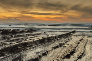 Barrika rocky beach at sunset