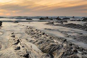 Barrika rocky beach at sunset