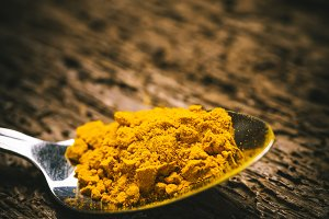 Curcuma powder , rustic background.