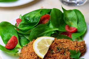 Baked in Bread Crumbs Chicken Fillet with Salad