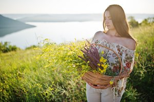 Girl on sunset meadow
