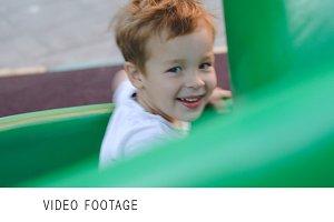 Happy child on slide outdoor