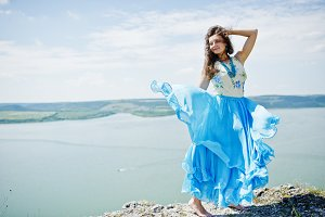 Girl on blue dress at nature