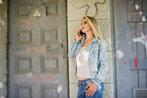 Blonde girl wear on jeans jacket