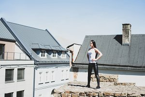 Girl is standing on the roof