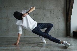 Teen boy doing breakdancing