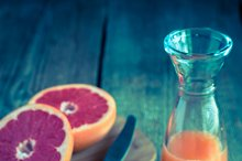 Grapefruit fresh on the wooden table