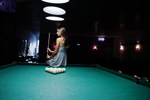 Girl next to billiards table