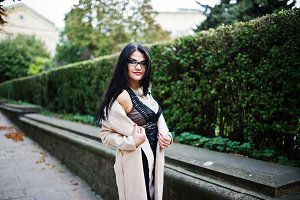 Black hair woman in glasses