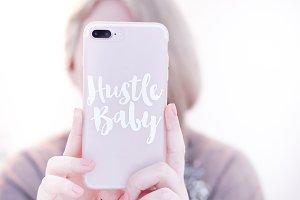 """""""Hustle Baby"""" - Girl Holding Phone"""