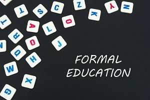 english colored square letters scattered on black background with text formal education