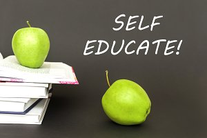 text self educate, two green apples, open books with concept