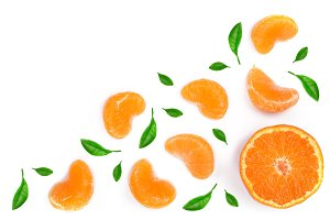 slices of mandarin or tangerine with leaves isolated on white background. Flat lay, top view. Fruit composition