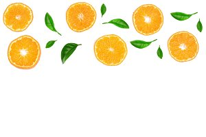 Slices of orange or tangerine with leaves isolated on white background with copy space for your text. Flat lay, top view