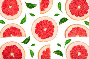 Grapefruit slices decorated with green leaves isolated on white background. Top view. Flat lay pattern