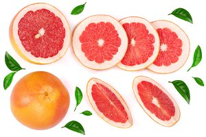 Grapefruit and slices decorated with green leaves isolated on white background. Top view. Set or collection