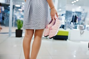 Girl in shoes boutique