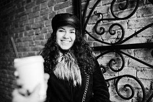 Curly mexican girl in leather cap