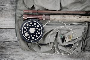 Old trout fishing gear on vest