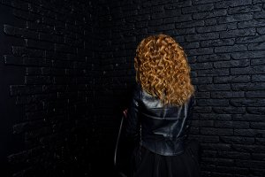 Curly hair girl in studio