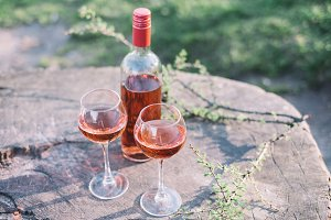 bootle and two glasses rose wine