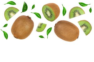 Kiwi fruit with slices isolated on white background with copy space for your text. Top view. Flat lay pattern
