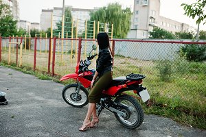 Girl and motor bike