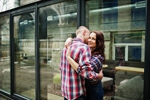 Stylish couple on checkered shirt