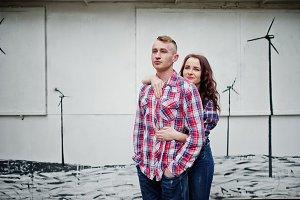 Stylish couple on checkered shirt