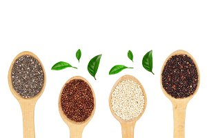 Black red white quinoa and chia seeds in wooden spoon isolated on white background with copy space for your text