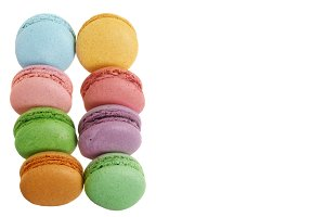 colored macarons isolated on white background without a shadow with copy space for your text. Top view. Flat lay